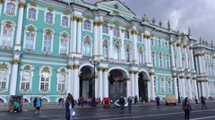 Hermitage Museum from Palace Square, famous building facade, windows, pan shot Stock Footage