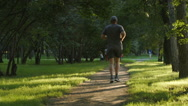 SLOW MOTION: Aged man runs on a footpath Stock Footage