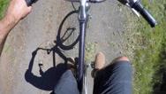 Man riding bike through beautiful green forest Stock Footage