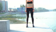 The girl doing squats with weights on the beach in the morning 4K Stock Footage