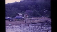 1963: men with children enjoying the coolness of the water in lake CAMDEN Stock Footage
