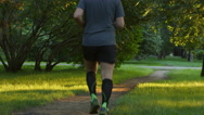 Aged man runs on a footpath in the summer Stock Footage
