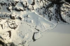 River Connecting to a Frozen Lake in the Mountains of British Columbia Stock Photos