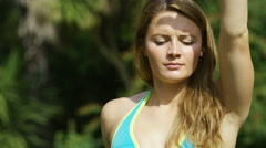 Attractive young woman in a yoga standing bow pose, in slow motion Stock Footage