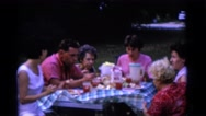 1963: family is enjoying food outdoor in a sunny day and wishing CAMDEN Stock Footage