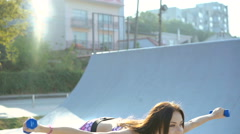 Young girl doing flexible exercise on the street in 4K Stock Footage