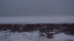 Pan along hudson bay coast during blizzard Stock Footage