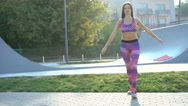 Young girl engages in fitness on the street in 4K Stock Footage