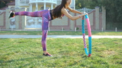 Young girl engages in fitness and posing on the street in 4K Stock Footage