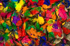 Pebbles painted bright colored paint Stock Photos