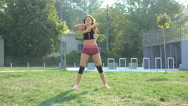 Pretty young girl doing active exercises on the street in 4K Stock Footage