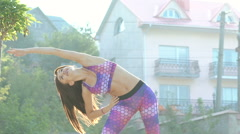 Pretty girl doing exercise with flexibility outdoor Stock Footage