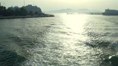 Ship put into harbor at sunset Stock Footage