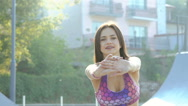 Sports young girl doing flexible exercise on the street Stock Footage