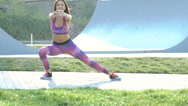 Sports young girl doing exercise for flexibility on the street Stock Footage