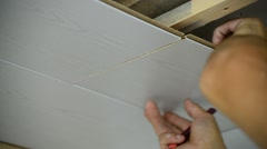 Worker makes the ceiling of MDF panels Stock Footage
