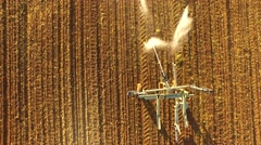 Industrial farming AERIAL of a field with a sprinkler system Stock Footage