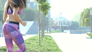 Girl running on the street in the morning. Slowly Stock Footage