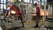 KARLOVY VARY, CZECH REPUBLIC - Glass blowers demonstrate Stock Footage