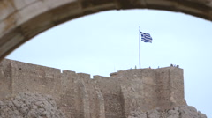 Ancient city wall with a Greek flag. Stock Footage
