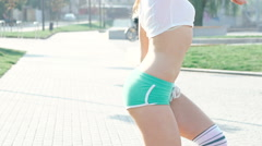 Active girl moving her body on the street. Slow motion Stock Footage