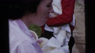 1961: woman holds a newborn sleeping baby and smokes a cigarette  Stock Footage
