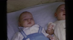 1961: two small infants in a crib  Stock Footage