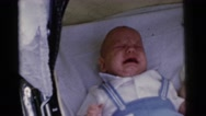 1961: crying baby is always difficult to handle against the silent  Stock Footage