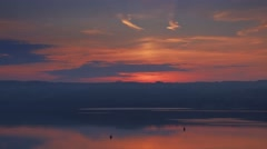 Rich orange sunrise on the river. Fast moving clouds, the sun rises. Stock Footage