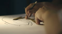 Two engineers working on the drawing. Only the hands and drawing. Stock Footage