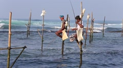 Fishermen are fishing in unique style. South Sri Lanka in Indian ocean Stock Footage