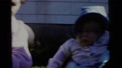 1961: two beautiful babies wearing hats. DETROIT, MICHIGAN Stock Footage