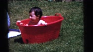 1961: a naked child is seen in a mini pool DETROIT, MICHIGAN Stock Footage