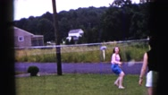 1961: a group of men and women playing badminton in a big green backyard. Stock Footage