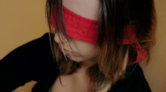 blindfolded girl squatting in a corner Stock Footage