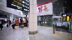 Interior of the airport in Kuala Lumpur. Descending on the escalator Stock Footage
