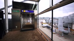 Corridor leading to the plane board in Hong Kong airport Stock Footage