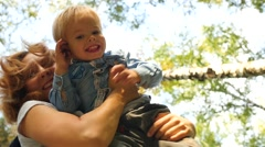 A mother and her child playing in the Park Stock Footage