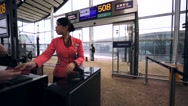 Airport worker checks passengers' boarding cards and passports Stock Footage