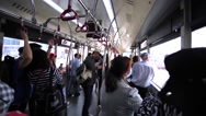 Passengers in the bus driving towards the plane in Hong Kong airport Stock Footage