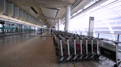 View of many empty luggage trolleys in the Hong Kong airport. Stock Footage