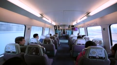View of ailse between seats in the aeroexpress train driving to the airport. Stock Footage