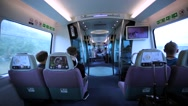 Walking between comfortable seats in Hong Kong train going fast to the airport. Stock Footage