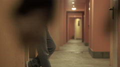 Lonely woman walking in a corridor is assaulted by a stranger Stock Footage