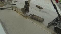 Excavator breaking sidewalk Stock Footage