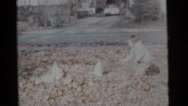 1963: kids having fun raking leaves and jumping into the pile CAMDEN, NEW JERSEY Stock Footage