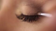 Process of applying eyeshadow, eye make up Stock Footage