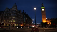 Big Ben and Red bus at night Stock Footage