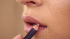 Process of lips make up with a paintbrush Stock Footage
