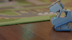 Bulldozer toy under christmas tree Stock Footage